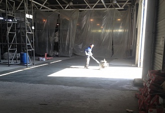 Work in warehouse concrete floor repair on site in Nizhny Novgorod